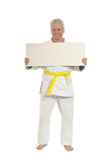 Karate  Senior man   with poster Stock Photo