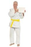 Karate  Senior man   with poster Royalty Free Stock Image