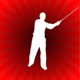 Karate Sensei with Sword on Glowing Red Background Royalty Free Stock Photo