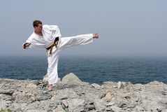 Karate on the shores of the sea Stock Images