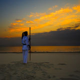 Karate on sunset beach. Young woman training karate on sunset beach Stock Images