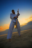 Karate on sunset beach Stock Photos