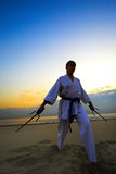 Karate on sunset beach Stock Images