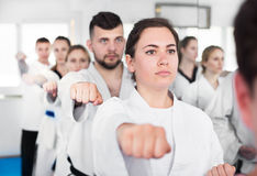 Karate teacher demonstrates techniques of receptions Stock Photography