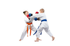 Karate techniques performed by the athletes in karategi. Karate techniques performed by the athletes Stock Photo