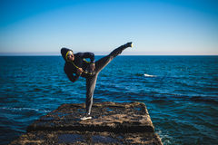 Karate training on the shores. Of the sea stock images