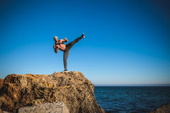 Karate training on the shores of the sea Stock Photography
