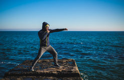 Karate training on the shores of the sea Royalty Free Stock Image