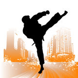 Karate vector. Karate silhouette with building background Royalty Free Stock Image