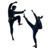 Karate vietvodao martial arts man woman couple silhouette. One caucasian men women couple exercising karate vietvodao martial arts in silhouette studio  on white Royalty Free Stock Photography