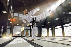 Karate woman in action Stock Photos