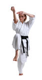 Karate. Young girl in a kimono. With a white background royalty free stock photos