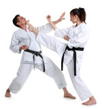 Karate. Young girl and a men in a kimono. Stock Photos