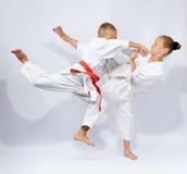 In karategi the children are beat karate blows Royalty Free Stock Photo