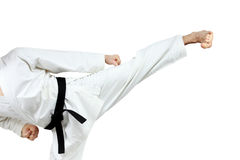 In karategi man doing kick yoko-geri Stock Image