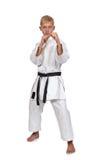 Karatejongen in kimono Stock Foto