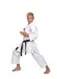 Karatejongen in kimono het vechten Stock Foto