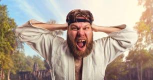 Karateka aggressivo immagini stock