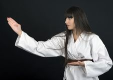 Karateka asian girl on black background studio shot Royalty Free Stock Photos