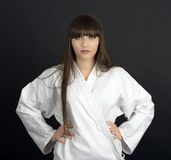 Karateka asian girl on black background studio shot Royalty Free Stock Images