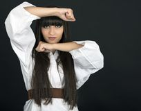 Karateka asian girl on black background studio shot Stock Images