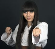 Karateka asian girl on black background studio shot Royalty Free Stock Photo