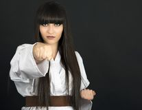Karateka asian girl on black background studio shot Royalty Free Stock Image