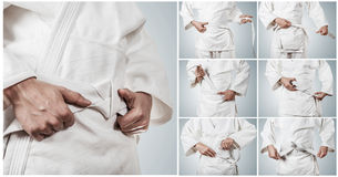 Karateka belt tying step by step pictures Stock Photos