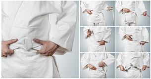Karateka belt tying step by step pictures Royalty Free Stock Photos