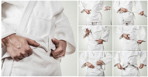 Karateka belt tying step by step pictures Royalty Free Stock Photography