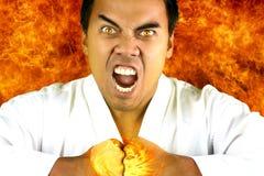 Karateka die woede uitdrukt Royalty-vrije Stock Foto