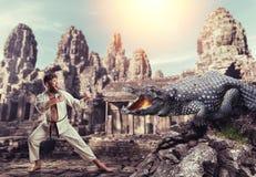 Karateka fights with crocodile Stock Images