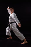 Karateka girl on black background Stock Photo