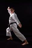 Karateka girl on black background stock photo