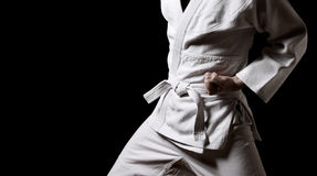 Karateka isolated on black Royalty Free Stock Photos