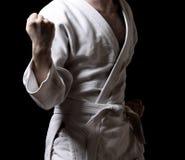 Karateka Isolated On Black Stock Photo