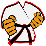 Karateka in kimono martial arts emblem Royalty Free Stock Image