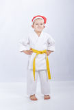 Karateka with a yellow belt and in cap of Santa Claus Royalty Free Stock Image