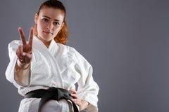 Karatevrouw stock afbeeldingen