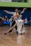 Karatkevich Vladimir und Kravchenko Nataliya Perform Adult Latin-American Program Lizenzfreie Stockfotografie