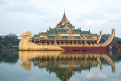Karaweik Hall at Kandawgyi Lake in Yangon royalty free stock image