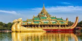 Karaweik royal barge, Kandawgyi Lake, Yangon. Panorama of Yangon icon landmark and tourist attraction:  Karaweik - replica of a Burmese royal barge at Kandawgyi Stock Image