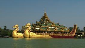 Karaweik temple in Kandawgyi lake, Yangon, Myanmar. Is a palace on the eastern shore of Kandawgyi Lake, Yangon, Burma. The barge was designed by Burmese stock video footage
