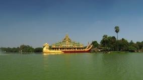 Karaweik temple in Kandawgyi lake, Yangon, Myanmar. Is a palace on the eastern shore of Kandawgyi Lake, Yangon, Burma. The barge was designed by Burmese stock footage