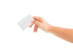 Kardieren Sie Leerzeichen in einer Hand Lizenzfreies Stockfoto