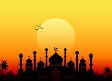 Kareem del Ramadán con la mezquita de la silueta Imagen de archivo