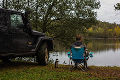 Karelian Isthmus, Leningrad, Russia, September 25, 2016 Jeep Wrangler on the lake, the Jeep Wrangler is a compact four wheel drive Royalty Free Stock Photo
