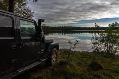 Karelian Isthmus, Leningrad, Russia, September 25, 2016 Jeep Wrangler on the lake, the Jeep Wrangler is a compact four wheel drive Royalty Free Stock Image