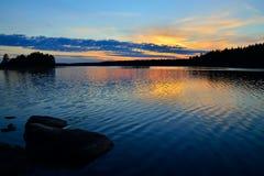 Karelian sunset. Lake Engozero, North Karelia, Russia Stock Photos