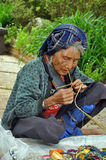 Karen hill tribe old women is weaving Stock Photography